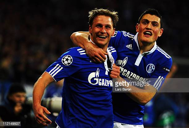 Benedikt Hoewedes of Schalke celebrates with team mate Kyriakos Papadopoulos after scoring a offside goal during the UEFA Champions League quarter...