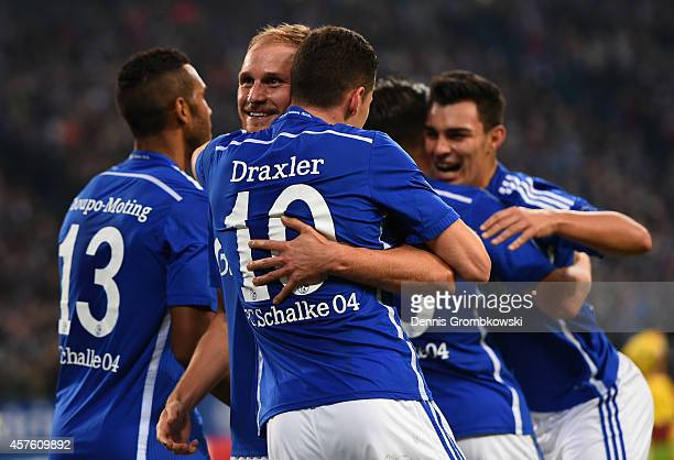 Benedikt Hoewedes of Schalke hugs Julian Draxler of Schalke after scoring their third goal during the UEFA Champions League Group G match between FC...
