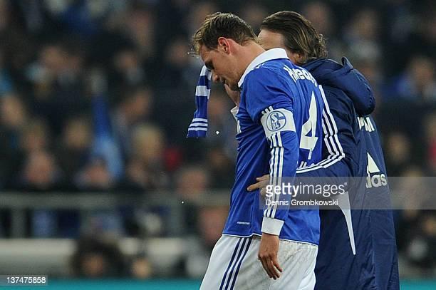 Benedikt Hoewedes of Schalke is brought off the pitch during the Bundesliga match between FC Schalke 04 and VfB Stuttgart at Veltins Arena on January...