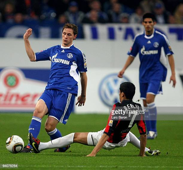 Benedikt Hoewedes of Schalke is challenged by Cicero of Berlin during the Bundesliga match between FC Schalke 04 and Hertha BSC Berlin at Veltins...
