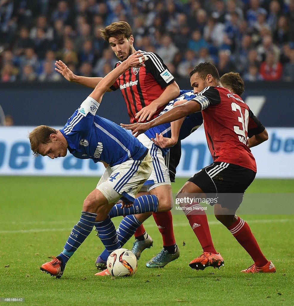 Benedikt Hoewedes of Schalke is challenged by Marvin Matip of Ingolstadt during the Bundesliga match between FC Schalke 04 and FC Ingolstadt at Veltins-Arena on October 31, 2015 in Gelsenkirchen, Germany.