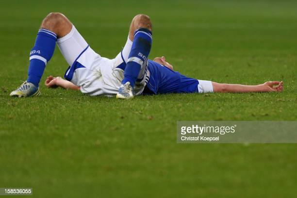 Benedikt Hoewedes of Schalke looks dejected after the DFB cup round of sixteen match between FC Schalke 04 and FSV Mainz 05 at Veltins-Arena on...