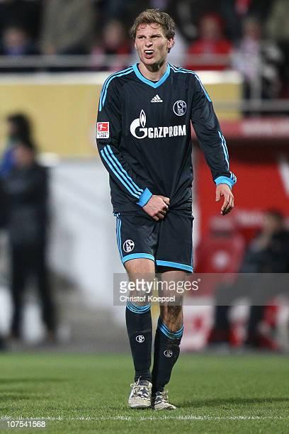 Benedikt Hoewedes of Schalke looks on during the Bundesliga match between FSV Mainz 05 and FC Schalke 04 at Bruchweg Stadium on December 12 2010 in...