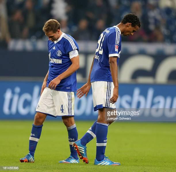 Benedikt Hoewedes of Schalke passes by Joel Matip after the Bundesliga match between FC Schalke 04 and FC Bayern Muenchen at VeltinsArena on...