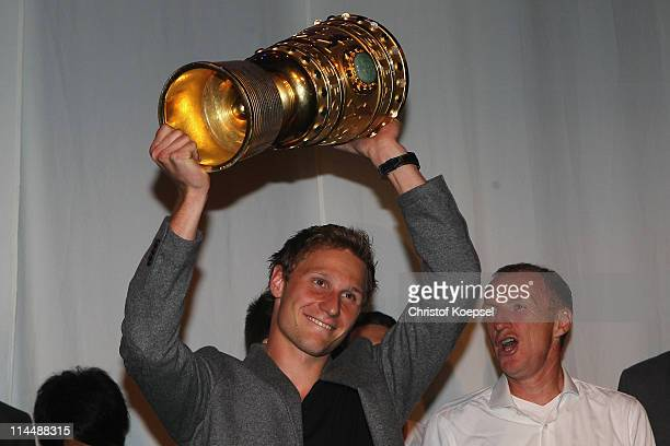 Benedikt Hoewedes of Schalke poses with the trophy during the celebration after the DFB Cup final match between MSV Duisburg and FC Schalke 04 at...