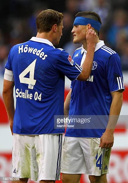 Benedikt Hoewedes of Schalke pulls the ear of team mate Kyriakos Papadopoulos during the Bundesliga match between FC Schalke 04 and 1899 Hoffenheim...