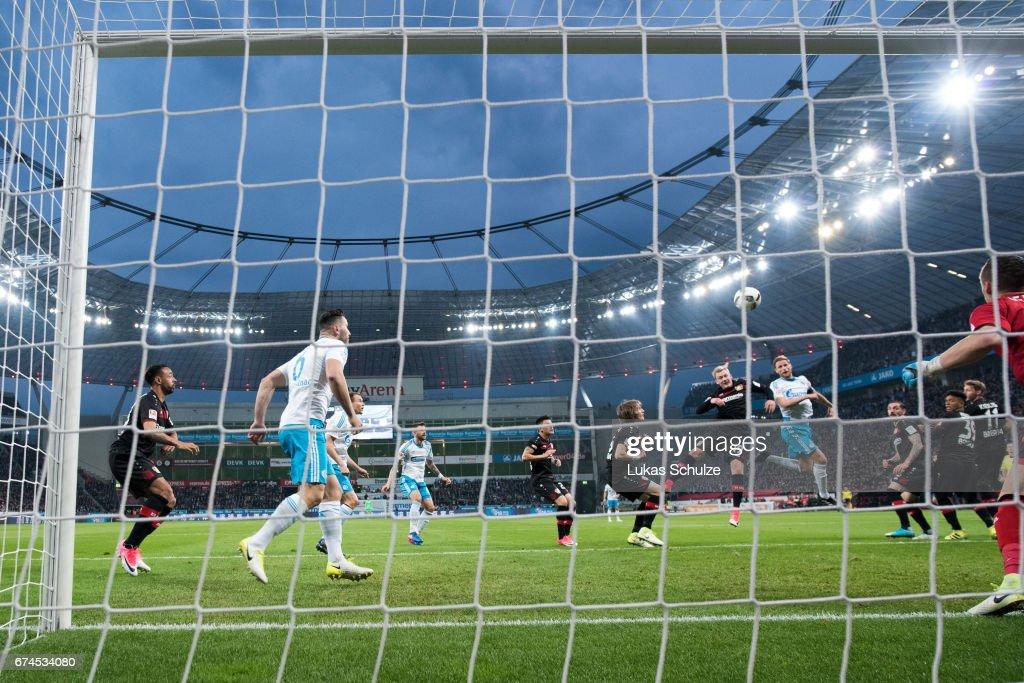 Benedikt Hoewedes (3R) of Schalke scores his teams second goal against Julian Brandt of Leverkusen during the Bundesliga match between Bayer 04 Leverkusen and FC Schalke 04 at BayArena on April 28, 2017 in Leverkusen, Germany.