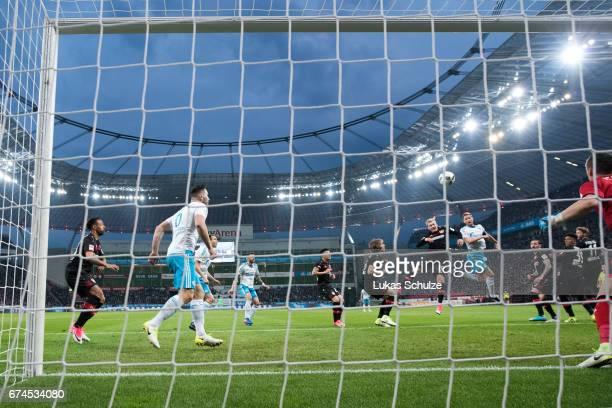 Benedikt Hoewedes of Schalke scores his teams second goal against Julian Brandt of Leverkusen during the Bundesliga match between Bayer 04 Leverkusen...