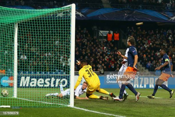 Benedikt Hoewedes of Schalke scores the first goal against Jonathan Ligali of Montpellier during the UEFA Champions League group B match between...