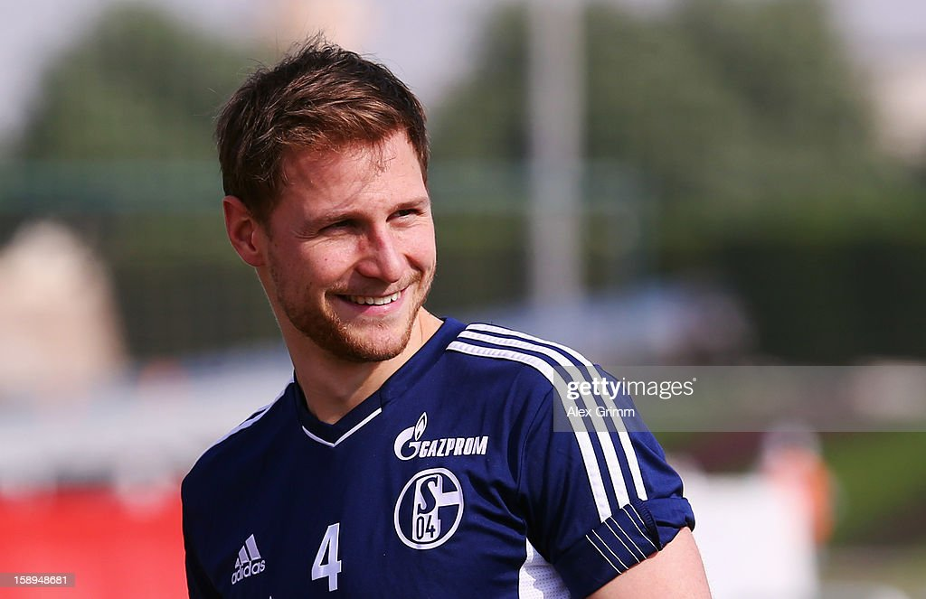Benedikt Hoewedes smiles during a Schalke 04 training session at the ASPIRE Academy for Sports Excellenc on January 4, 2013 in Doha, Qatar.
