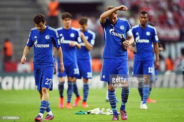 Benedikt Hoewedes , Tranquillo Barnetta and team mates of Schalke react after the Bundesliga match between 1. FC Koeln and FC Schalke 04 at...