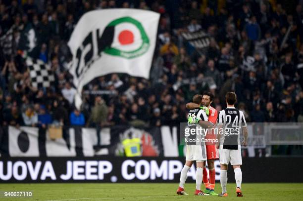 Benedikt Howedes Gianluigi Buffon and Daniele Rugani celebrate the victory at the end of the Serie A football match between Juventus FC and UC...