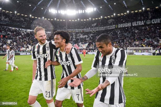 Benedikt Howedes Juan Cuadrado and Douglas Costa of Juventus celebrate the victory at the end of the serie A match between Juventus and UC Sampdoria...