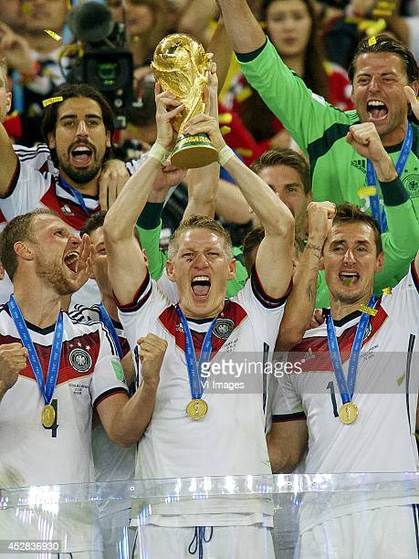 Benedikt Howedes of Germany Bastian Schweinsteiger of Germany Miroslav Klose of Germany with World Cup trophy during the final of the FIFA World Cup...