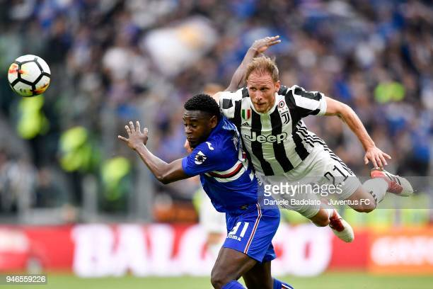 Benedikt Howedes of Juventus competes for the ball with Duvan Zapata of UC Sampdoria during the serie A match between Juventus and UC Sampdoria at...