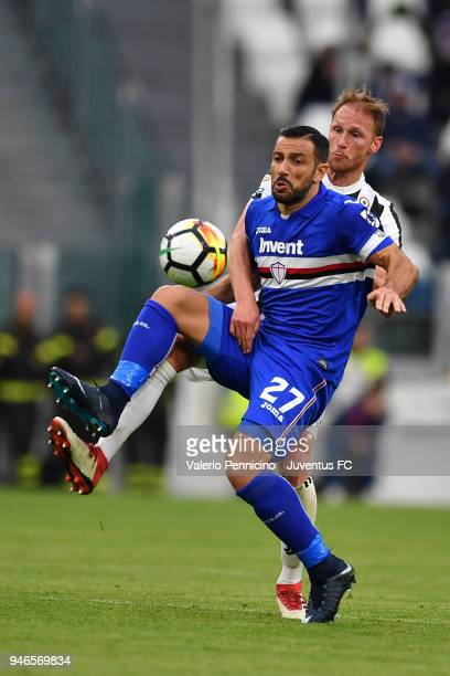 Benedikt Howedes of Juventus competes for the ball with Fabio Quagliarella of UC Sampdoria during the serie A match between Juventus and UC Sampdoria...