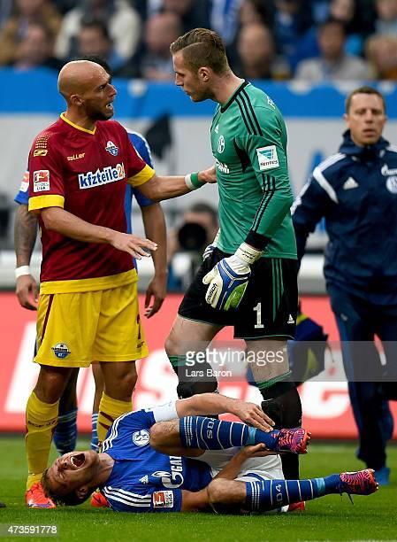 Benedikt Howedes of Schalke 04 lies injured on the pitch after a tackle of Daniel Bruckner of SC Paderborn during the Bundesliga match between FC...