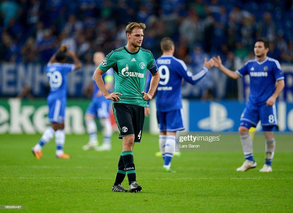Benedikt Howedes of Schalke 04 look dejected during the UEFA Champions League Group E match between FC Schalke 04 and Chelsea at Veltins-Arena on October 22, 2013 in Gelsenkirchen, Germany.