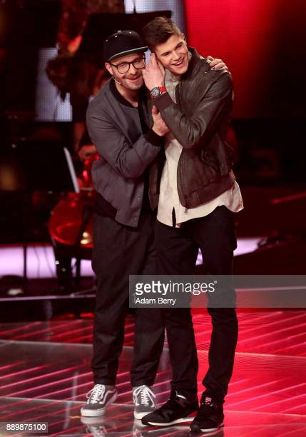 Benedikt Koestler is congratulated by Mark Forster after winning the 'The Voice of Germany' semifinals at Studio Berlin Adlershof on December 10 2017...