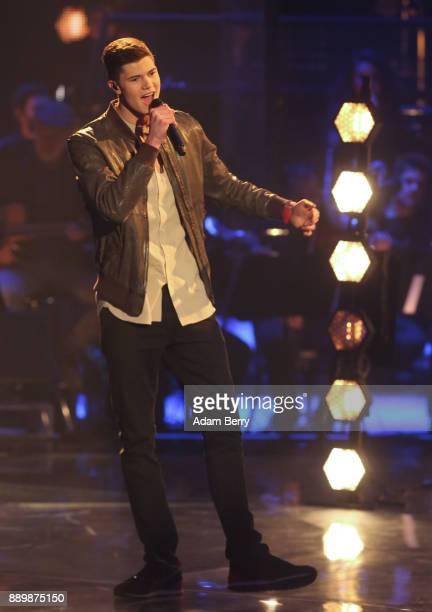 Benedikt Koestler performs during the 'The Voice of Germany' semifinals at Studio Berlin Adlershof on December 10 2017 in Berlin Germany The finals...