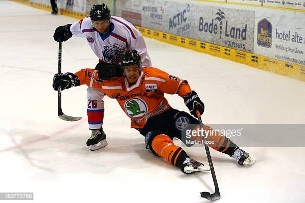 Benedikt Kohl of Wolfsburg and Peter Lindlbauer of Nuernberg battle for the puck in game two of the DEL preplayoffs between Grizzly Adams Wolfsburg...