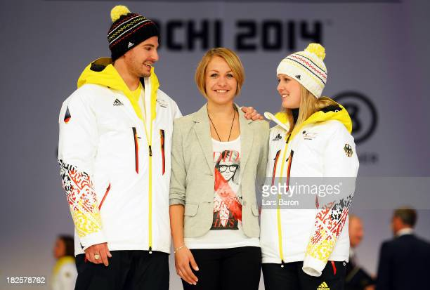 Benedikt Mayr former Biathlon athlet Magdalena Neuner and Andrea Rothfuss pose during the German Olympic and Paralympic team kit presentation at...
