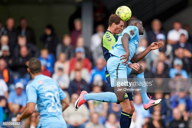 Benedikt Röcker of Brondby IF and Mayron George of Randers FC compete for the ball during the Danish Alka Superliga match between Randers FC and...