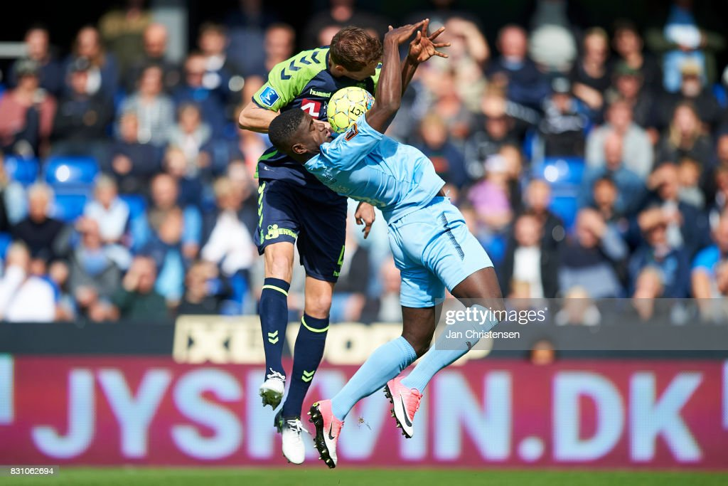 Benedikt Röcker of Brondby IF and Mayron George of Randers FC heading the ball during the Danish Alka Superliga match between Randers FC and Brondby IF at BioNutria Park Randers on August 13, 2017 in Randers, Denmark.