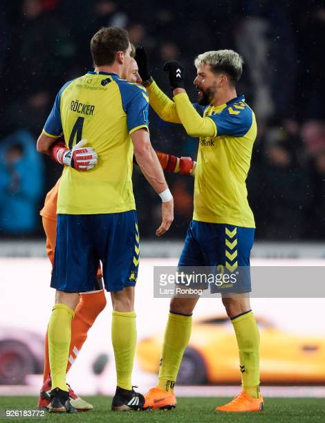 Benedikt Rocker Goalkeeper Frederik Ronnow of Brondby IF and Anthony Jung of Brondby IF celebrate after the Danish Alka Superliga match between FC...