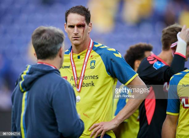 Benedikt Rocker of Brondby IF and Alexander Zorniger head coach of Brondby IF with their silver medals after the Danish Alka Superliga match between...