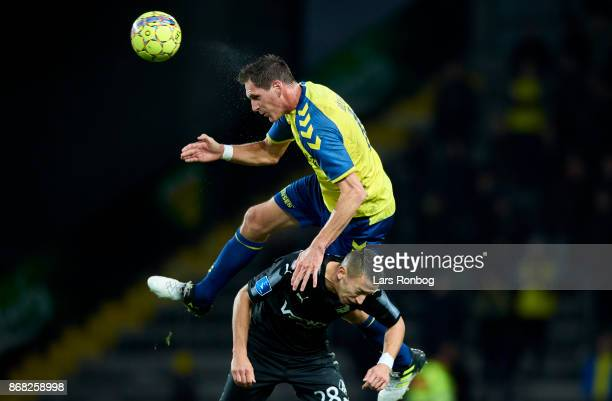 Benedikt Rocker of Brondby IF and Nikola Djurdjic of Randers FC compete for the ball during the Danish Alka Superliga match between Brondby IF and...