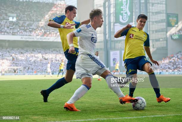 Benedikt Rocker of Brondby IF Viktor Fischer of FC Copenhagen and Christian Norgaard of Brondby IF compete for the ball during the Danish Alka...