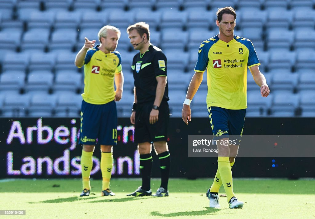 Benedikt Rocker of Brondby IF walks off the pitch after receiving a red card from referee Jens Grabski Maae during the Danish Alka Superliga match between AGF Aarhus and Brondby IF at Ceres Park on August 20, 2017 in Aarhus, Denmark.