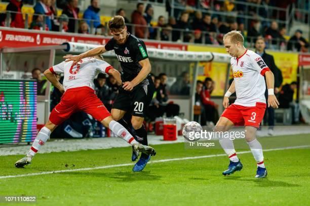 Benedikt Saller of Jahn Regensburg Alexander Nandzik of Jahn Regensburg and Salih Oezcan of Koeln battle for the ball during the Second Bundesliga...