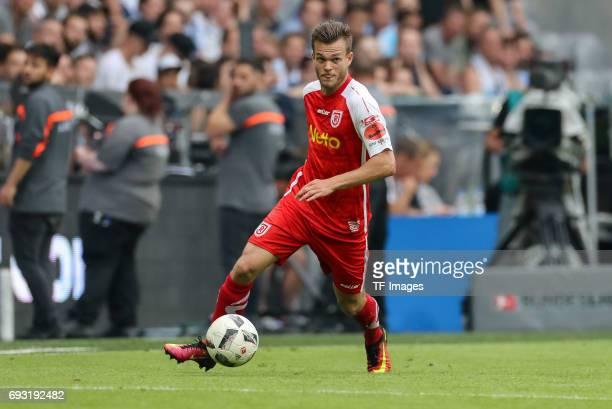 Benedikt Saller of Jahn Regensburg controls the ball during the Second Bundesliga Playoff second leg match between TSV 1860 Muenchen and Jahn...