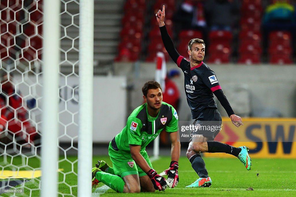 Benedikt Saller of Mainz celebrates his team's second goal as goalkeeper Sven Ulreich of Stuttgart reacts during the Bundesliga match between VfB Stuttgart and 1. FSV Mainz 05 at Mercedes-Benz Arena on January 25, 2014 in Stuttgart, Germany.