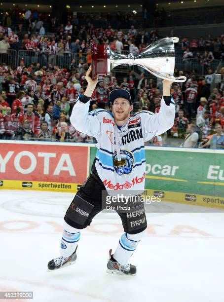 Benedikt Schopper holds the trophy after game seven of the DEL playoff final on April 29, 2014 in Cologne, Germany.