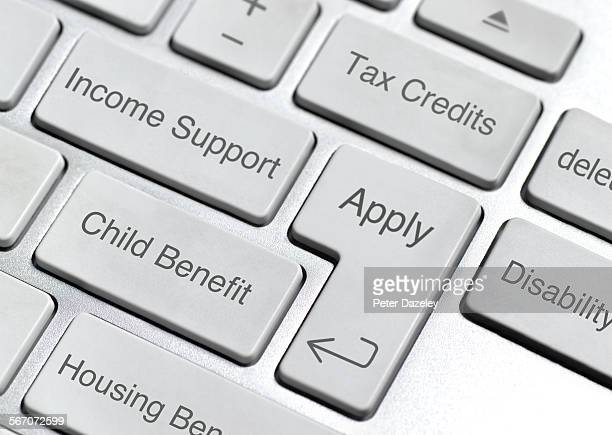 benefit and social security keyboard - social services stock pictures, royalty-free photos & images
