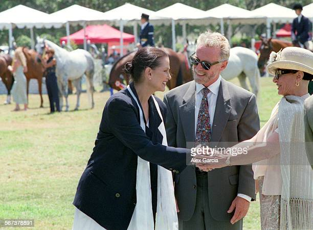 LSbenefit0811AAG––Actress Veronica Hamel is greeted by co–chairs Diana Casey and Michael Mudd at the GTE Everything Pages equestrian competition...