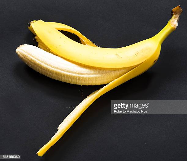 Benefits of banana fruit over black background The fruit has a lot of potassium which is helpful in maintaining blood pressure