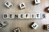Benefits word from wooden blocks