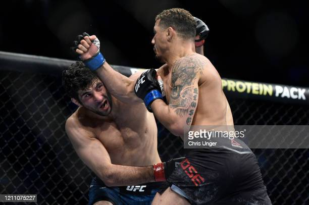 Beneil Dariush and Drakkar Klose trade punches in their lightweight fight during the UFC 248 event at T-Mobile Arena on March 07, 2020 in Las Vegas,...