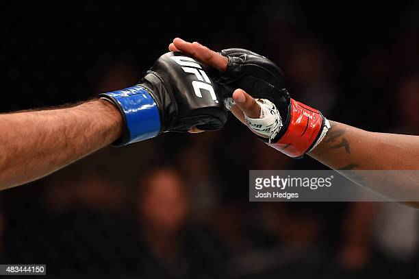 Beneil Dariush and Michael Johnson touch gloves before facing each other in their lightweight bout during the UFC Fight Night event at Bridgestone...