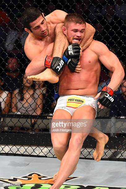 Beneil Dariush attempts a submission against Daron Cruickshank in their lightweight bout during the UFC 185 event at the American Airlines Center on...