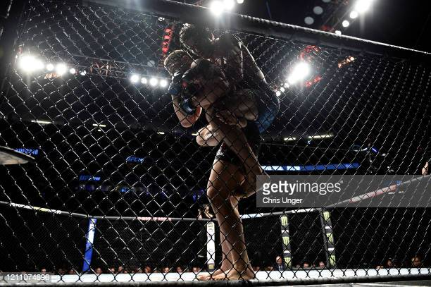 Beneil Dariush attempts to secure a rear choke submission against Drakkar Klose in their lightweight fight during the UFC 248 event at T-Mobile Arena...