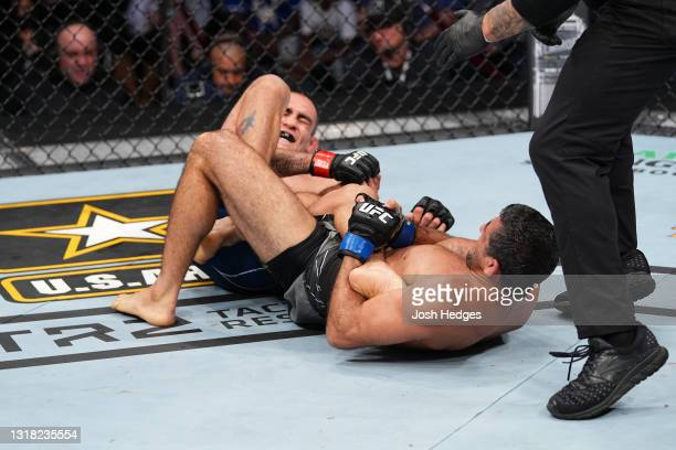 Beneil Dariush attempts to submit Tony Ferguson in their lightweight bout during the UFC 262 event at Toyota Center on May 15, 2021 in Houston, Texas.