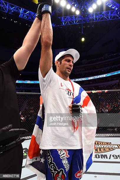 Beneil Dariush celebrates after defeating Daron Cruickshank in their lightweight bout during the UFC 185 event at the American Airlines Center on...