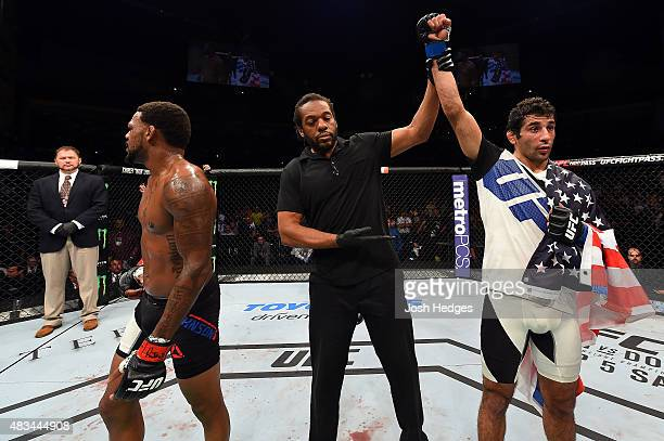 Beneil Dariush celebrates after defeating Michael Johnson in their lightweight bout during the UFC Fight Night event at Bridgestone Arena on August 8...