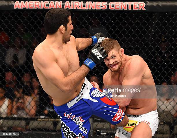 Beneil Dariush kicks Daron Cruickshank in their lightweight bout during the UFC 185 event at the American Airlines Center on March 14 2015 in Dallas...