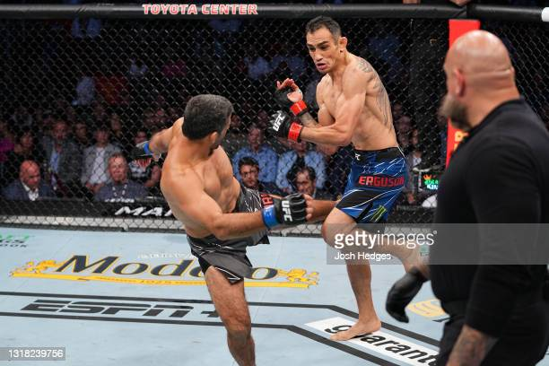 Beneil Dariush kicks Tony Ferguson in their lightweight bout during the UFC 262 event at Toyota Center on May 15, 2021 in Houston, Texas.
